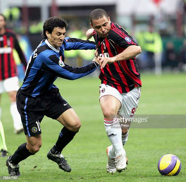 Nicolas Burdisso of Inter challenges Ronaldo of AC Milan during the Serie A match between Inter Milan and AC Milanat the San Siro Stadium on March 11...