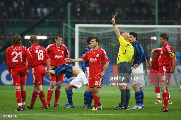 Nicolas Burdisso of Inter reacts after being shown the red card by Referee, Tom Henning Ovrebo of Norway for a bad challenge on Lucas Leiva of...