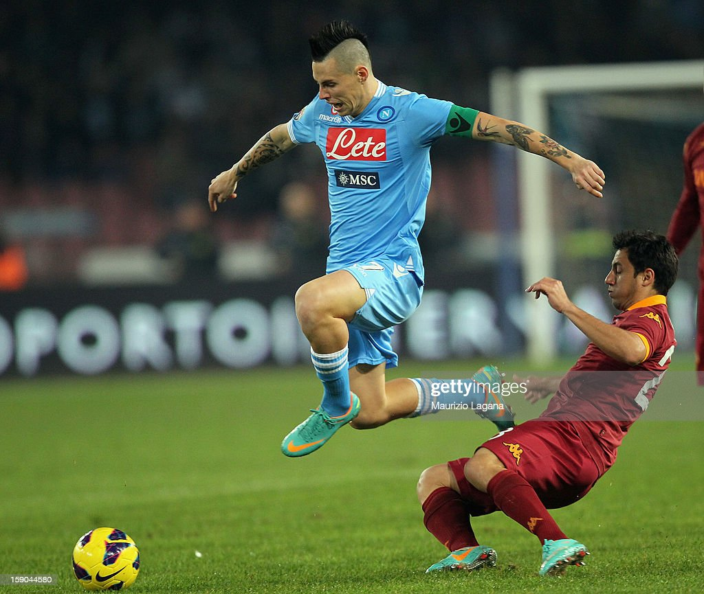 Nicolas Burdisso (R) of Roma competes for the ball with Marek Hamsik of Napoli during the Serie A match between SSC Napoli and AS Roma at Stadio San Paolo on January 6, 2013 in Naples, Italy.