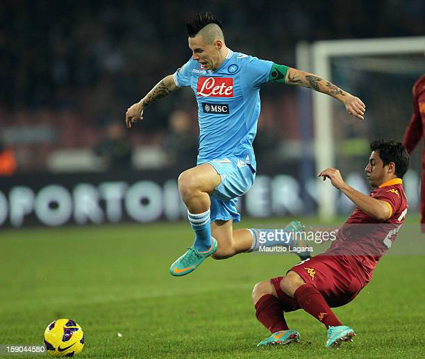 Nicolas Burdisso of Roma competes for the ball with Marek Hamsik of Napoli during the Serie A match between SSC Napoli and AS Roma at Stadio San...