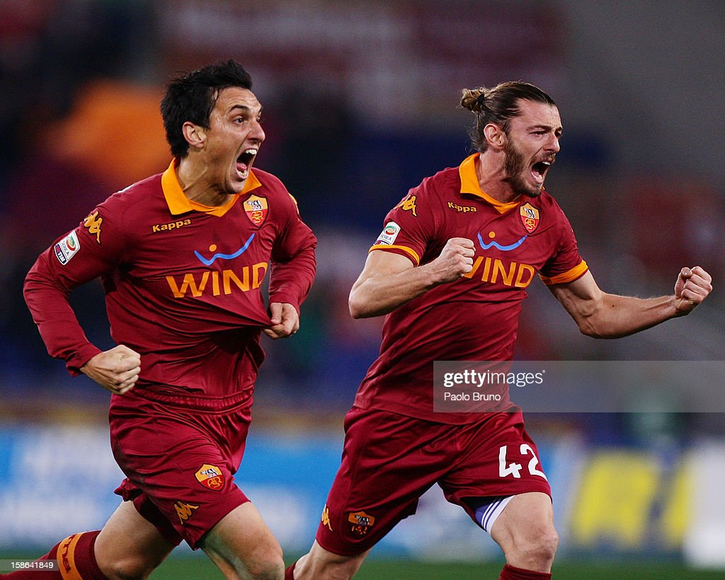 Nicolas Burdisso (R) with his teammate Federico Balzaretti of AS Roma celebrates after scoring the opening goal during the Serie A match between AS Roma and AC Milan at Stadio Olimpico on December 22, 2012 in Rome, Italy.