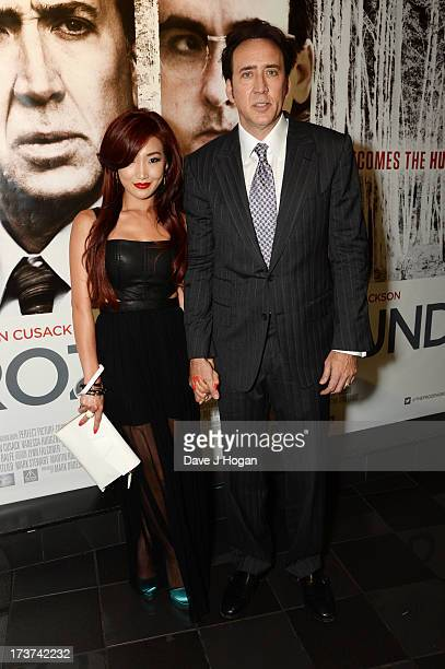 Nicolas Cage and Alice Kim attend the UK premiere of 'The Frozen Ground' at The Vue Leicester Square on July 17 2013 in London England