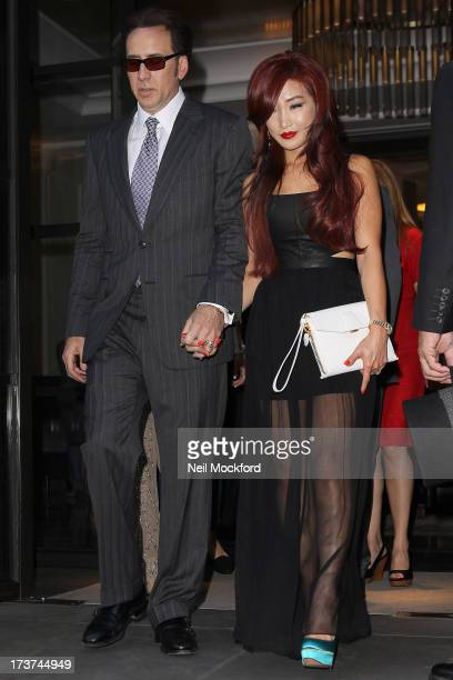 Nicolas Cage and Alice Kim seen leaving their hotel ahead of the Film Premiere of 'The Frozen Ground' on July 17 2013 in London England