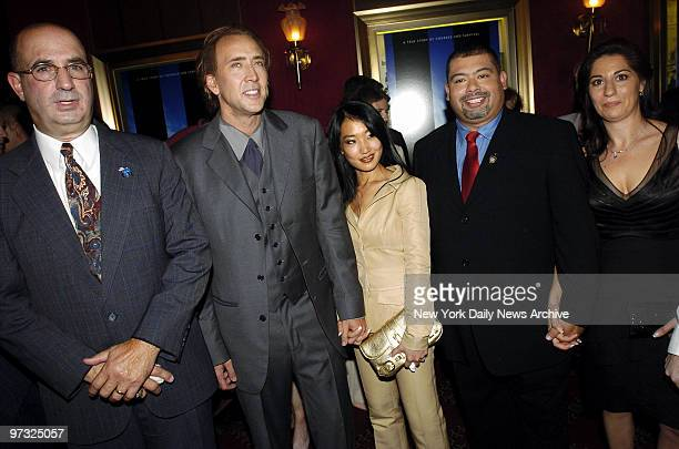 Nicolas Cage and his wife Alice Kim are joined by Port Authority Police Officers John McLoughlin and William J Jimeno and Jimeno's wife Allison at...