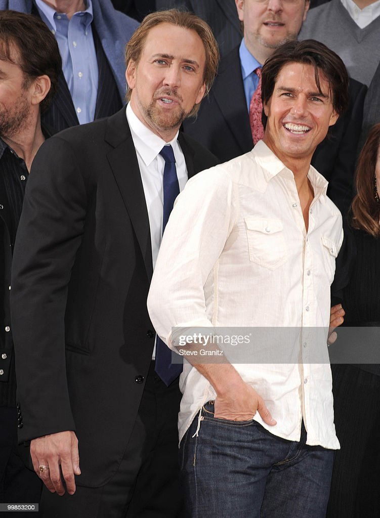 Nicolas Cage and Tom Cruise attends the Jerry Bruckheimer Hand And Footprint Ceremony at Grauman's Chinese Theatre on May 17, 2010 in Hollywood, California.