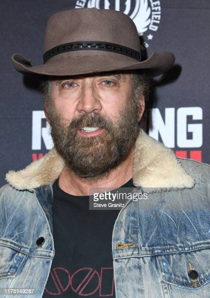 """Nicolas Cage arrives at the Premiere Of Quiver Distribution's """"Running With The Devil"""" at Writers Guild Theater on September 16, 2019 in Beverly..."""