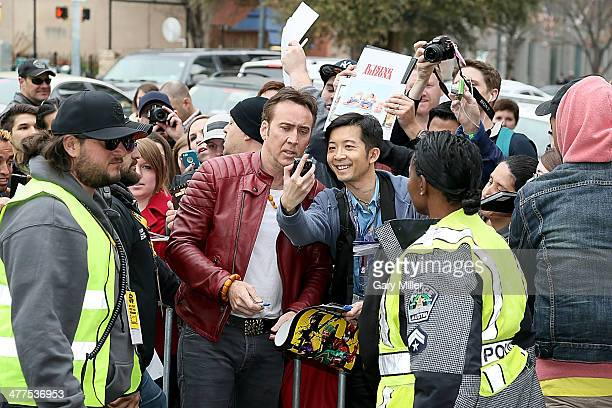 Nicolas Cage interacts with fans before the premiere of his new film 'Joe' during the South By Southwest Film Festival on March 9 2014 in Austin Texas