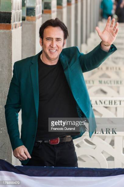Nicolas Cage poses next to the beach closet dedicated to him during a photocall on the Promenade des Planches for the movie 'Joe' during the 39th...