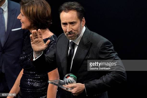 Nicolas Cage reacts after being awarded with the honorary award during the German Sustainability Award 2016 at Maritim Hotel on November 25, 2016 in...