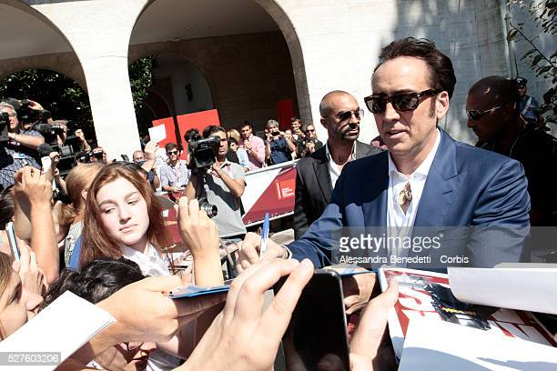 Nicolas Cage signs autographs to fans during the promotion of movie Joe presented in competition during the 70th international Venice Film Festival