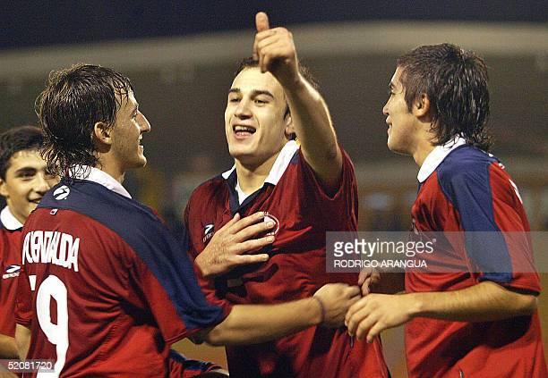 Nicolas Canales de Chile celebra su gol contra Venezuela junto a Jose Fuenzalida y Felipe Munoz durante el partido de la ronda final del campeonato...
