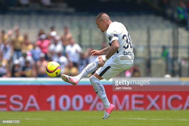 Nicolas Castillo kicks the ball to score the second goal of Pumas during the 15th round match between Pumas UNAM and Puebla as part of the Torneo...