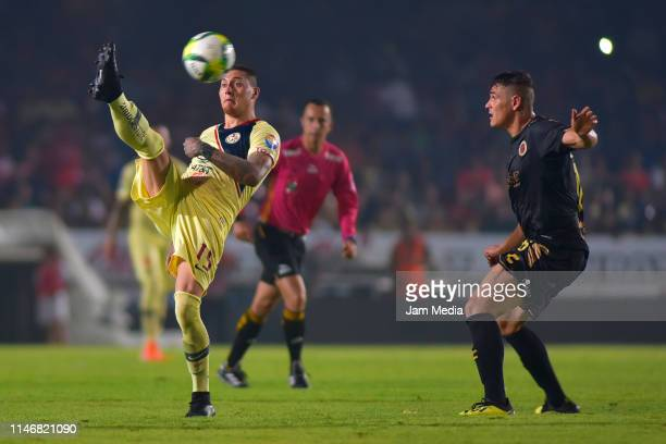 Nicolas Castillo of America fights for the ball with Lampros Kontogiannis of Veracruz during the 17th round match between Veracruz and America as...
