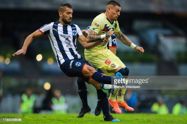 Nicolas Castillo of America struggles for the ball against Nicolas Sanchez of Monterrey during the 1st round match between America and Monterrey as...