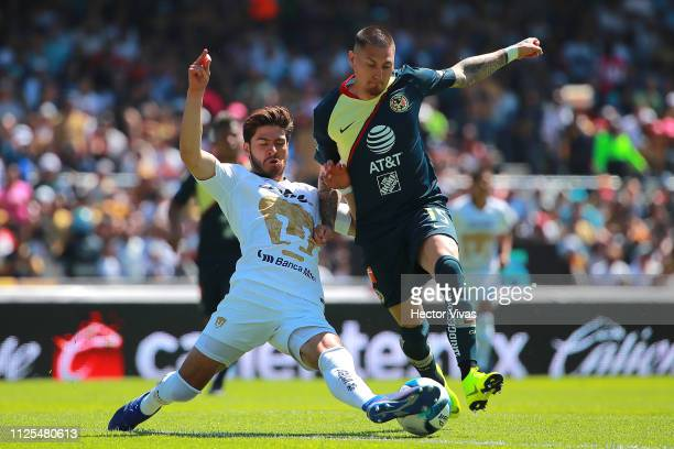 Nicolas Castillo of America struggles for the ball with Pablo Jaquez of Pumas during the seventh round match between Pumas UNAM and America as part...
