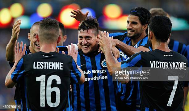 Nicolas Castillo of Brugge celebrates scoring the second goal of the game with team mates during the UEFA Europa League 3rd qualifying round first...
