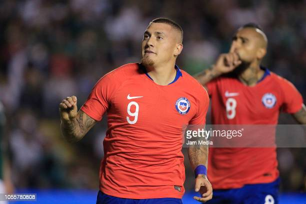 Nicolas Castillo of Chile celebrates after scoring the first goal of his team during the international friendly match between Mexico and Chile at La...