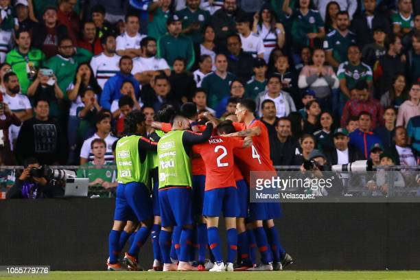 Nicolas Castillo of Chile celebrates with teammates after scoring the first goal of his team during the international friendly match between Mexico...