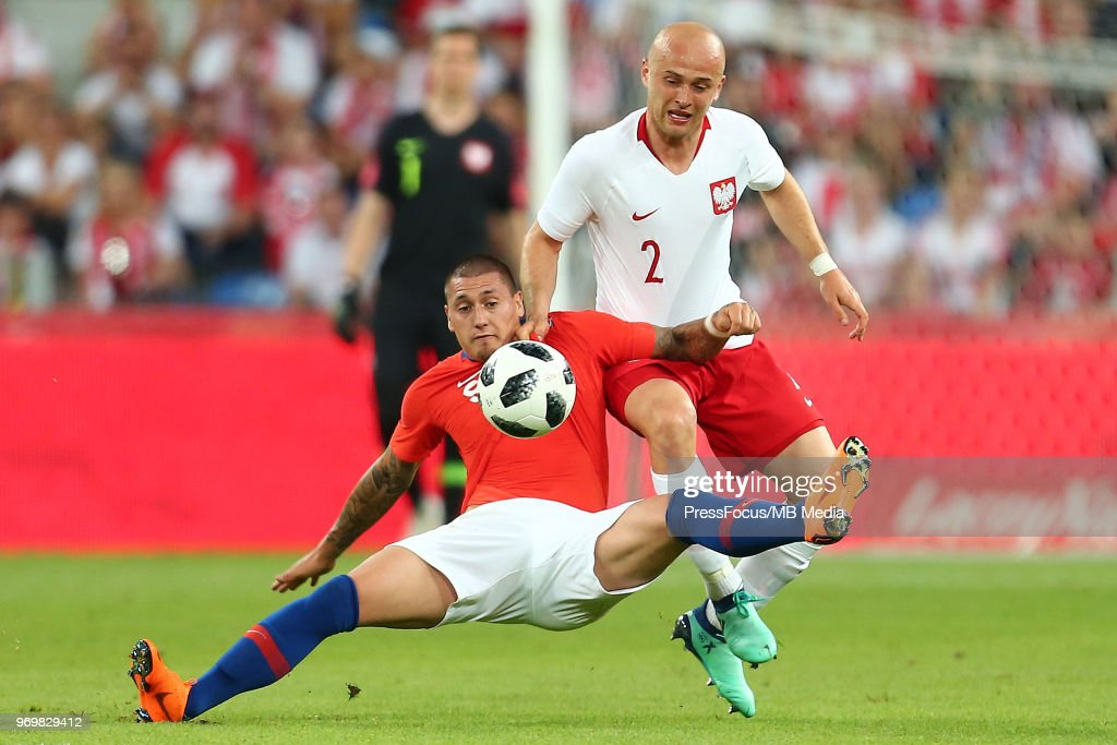 Nicolas Castillo of Chile competes with Michal Pazdan of Poland during International Friendly match between Poland and Chile on June 8, 2018 in Poznan, Poland.