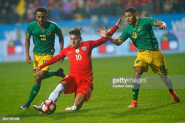 Nicolas Castillo of Chile fights for the ball with Joel Mcanuff of Jamaica during an international friendly match between Chile and Jamaica at...