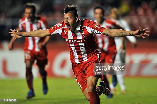 Nicolas Castillo, of Chiles Universidad Catolica, celebrates after scoring against Brazil's Sao Paulo, during their 2013 Copa Sudamericana football...