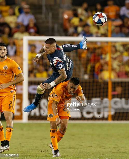 Nicolas Castillo of Club America flips over Darwin Ceren of Houston Dynamo as he goes up for a header in the second half during a quarterfinal 2019...