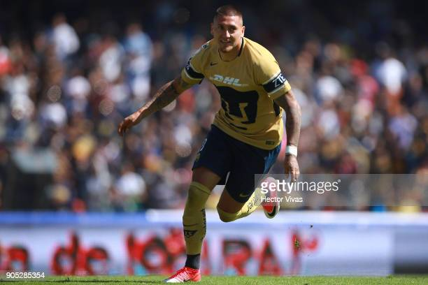Nicolas Castillo of Pumas celebrates after scoring the third goal of his team during the second round match between Pumas UNAM and Atlas as part of...