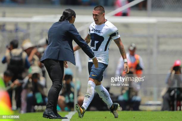 Nicolas Castillo of Pumas celebrates with his coach Juan Francisco Palencia after scoring the second goal of his team during the fourth round match...