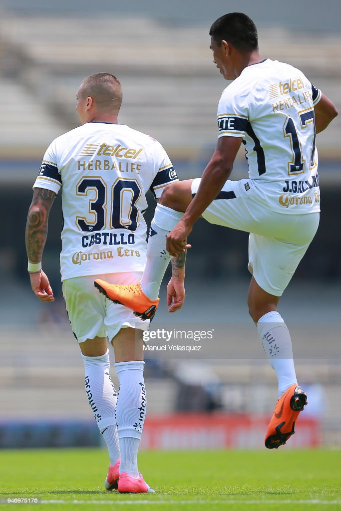 Nicolas Castillo of Pumas celebrates with teammate Jesus Gallardo after scoring a goal during the 15th round match between Pumas UNAM and Puebla as part of the Torneo Clausura 2018 Liga MX at Olimpico Universitario Stadium on April 15, 2018 in Mexico City, Mexico.