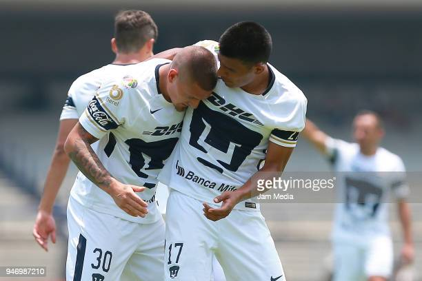Nicolas Castillo of Pumas celebrates with teammate Jesus Gallardo after scoring the first goal of his team during the 15th round match between Pumas...