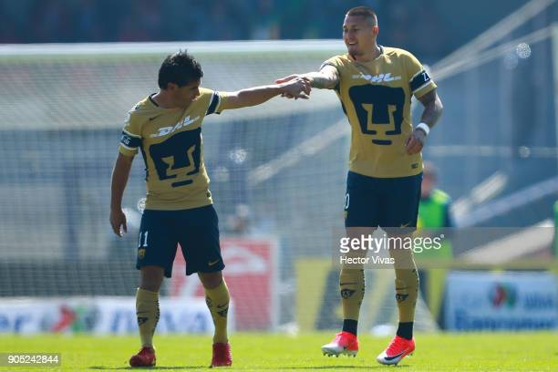 Nicolas Castillo of Pumas celebrates with teammate Matias Alustiza after scoring the first goal of his team during the second round match between...