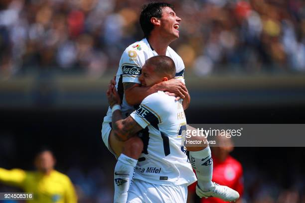 Nicolas Castillo of Pumas celebrates with teammate Matias Alustiza after scoring the first goal of his team during the 9th round match between Pumas...