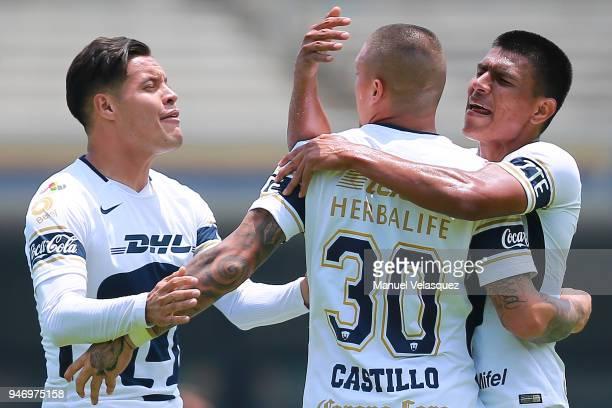 Nicolas Castillo of Pumas celebrates with teammates Jesus Gallardo and Pablo Barrera after scoring a goal during the 15th round match between Pumas...