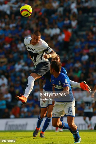 Nicolas Castillo of Pumas fights for the ball with Adrian Aldrete of Cruz Azul during the 12th round match between Cruz Azul and Pumas UNAM as part...