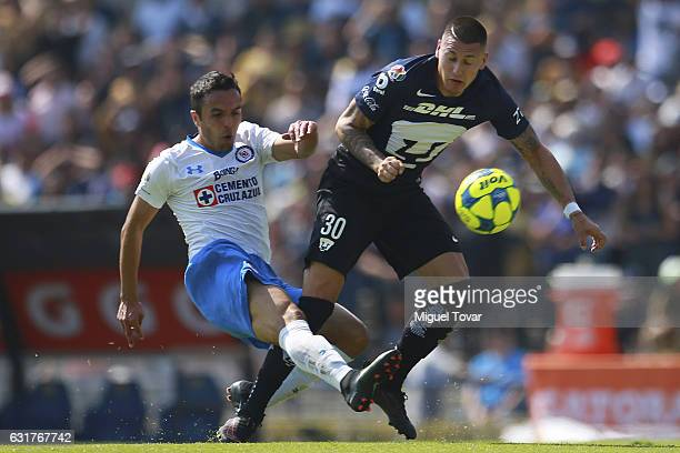 Nicol‡as Castillo of Pumas is fouled by Omar Mendoza of Cruz Azul during the 2nd round match between Pumas UNAM and Cruz Azul as part of the Torneo...