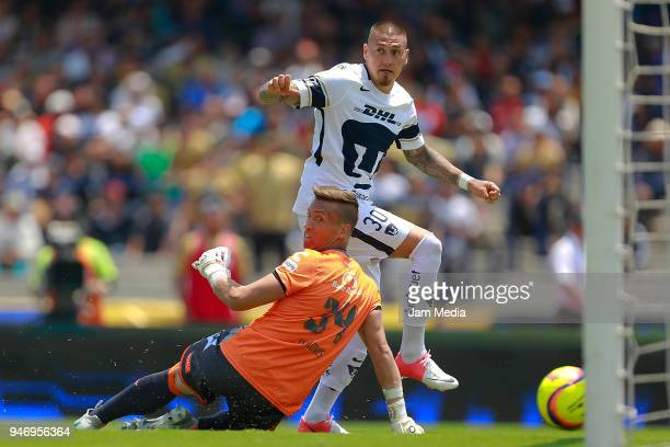 Nicolas Castillo of Pumas scores the first goal against Nicolas Vikonis goalkeeper of Puebla during the 15th round match between Pumas UNAM and...