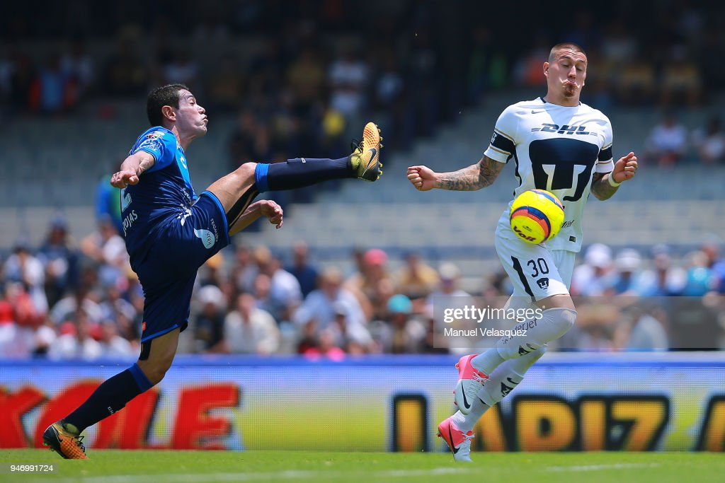 Nicolas Castillo (R) of Pumas struggles for the ball against Oscar Rojas (L) of Puebla during the 15th round match between Pumas UNAM and Puebla as part of the Torneo Clausura 2018 Liga MX at Olimpico Universitario Stadium on April 15, 2018 in Mexico City, Mexico.