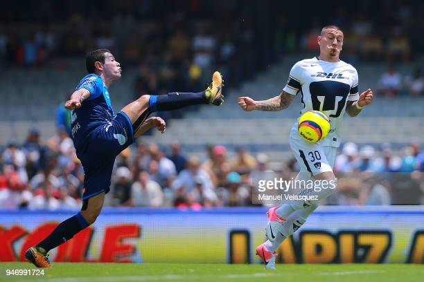 Nicolas Castillo of Pumas struggles for the ball against Oscar Rojas of Puebla during the 15th round match between Pumas UNAM and Puebla as part of...