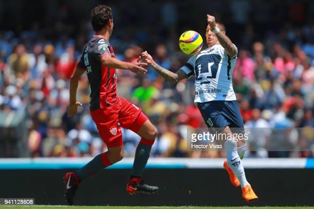 Nicolas Castillo of Pumas struggles for the ball with Igor Lichnovsky of Necaxa during the 13th round match between Pumas UNAM and Necaxa as part of...