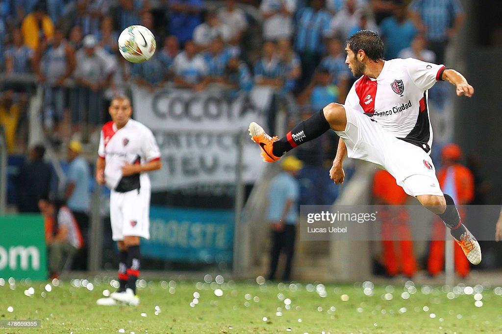 Nicolas Castro of Newell's Old Boys runs for the ball during the Copa Bridgestone Libertadores 2014 match between Gremio v Newell's Old Boys (ARG) at Arena do Gremio Stadium on March 13, 2014 in Porto Alegre, Brazil.