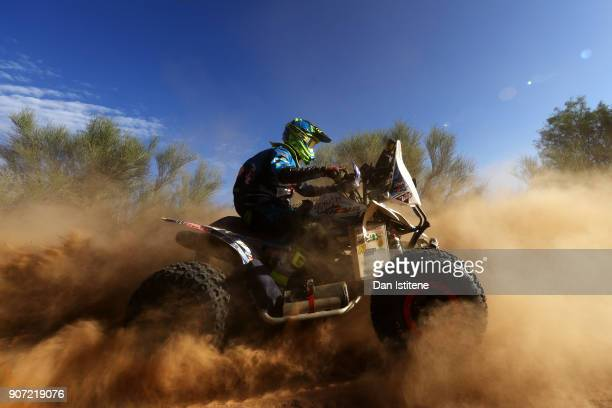 Nicolas Cavigliasso of Argentina and Team al Desert rides a Yamaha YFZ 450 quad bike in the Classe GQ1 2 Roues Motrices 0 during stage thirteen of...