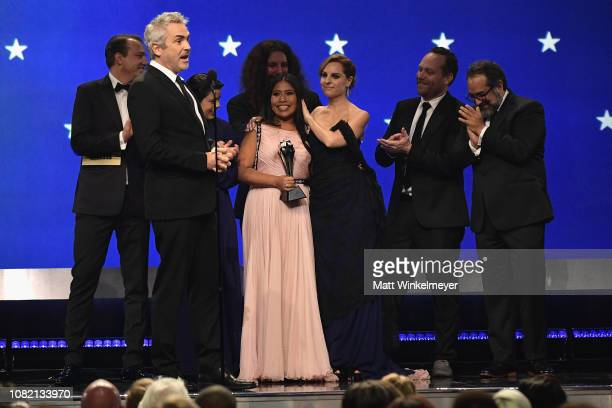 Nicolas Celis, Alfonso Cuaron, Yalitza Aparicio, Adam Gough, Marina De Tavira, Bryce Nielsen, and Eugenio Caballero accept the Best Picture award for...