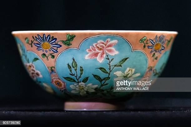 Nicolas Chow deputy chairman for Sotheby's Asia holds an extremely rare Qing Dynasty bowl one of only three known to exist during a media preview at...