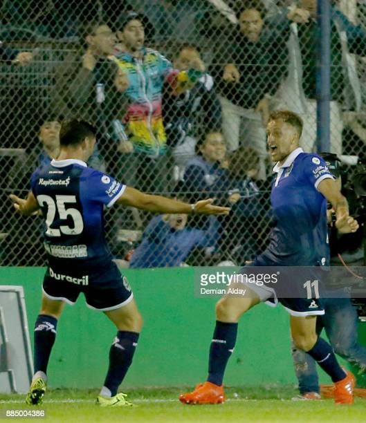 Nicolas Colazo of Gimnasia y Esgrima celebrates with teammate Lucas Licht after scoring the first goal of his team during a match between Gimnasia y...