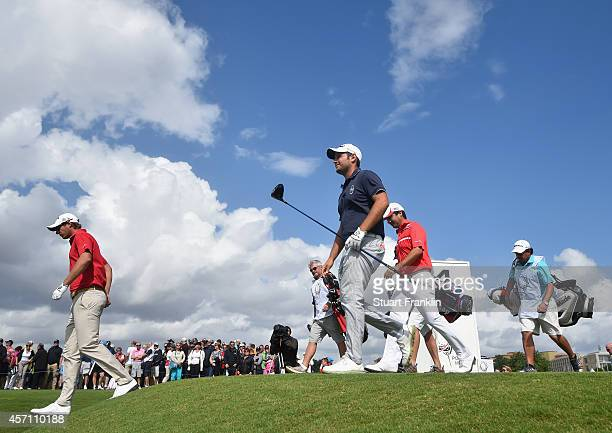 Nicolas Colsaerts of Belgium Alexander Levy of France and Felipe Aguilar of Chile walk on the first hole during the final round of the Portugal...