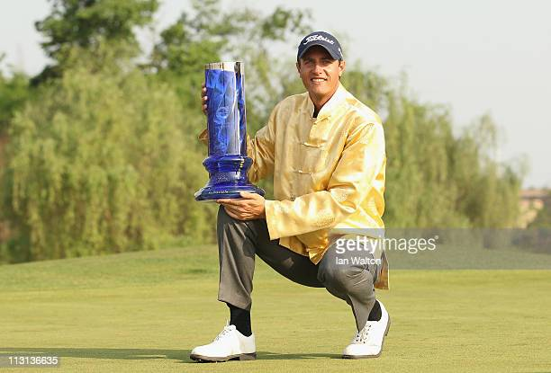 Nicolas Colsaerts of Belgium celebrates with the trophy after winning the Volvo China Open at Luxehills Country Club on April 24, 2011 in Chengdu,...