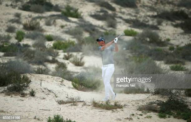Nicolas Colsaerts of Belgium plays a shot on the 8th hole during the first round of the Omega Dubai Desert Classic at Emirates Golf Club on February...
