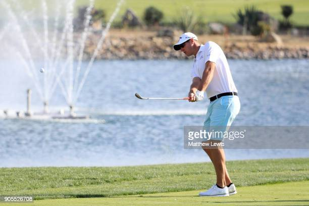 Nicolas Colsaerts of Belgium plays a shot on the ninth hole during practice rounds for the Abu Dhabi HSBC Golf Championship at Abu Dhabi Golf Club on...