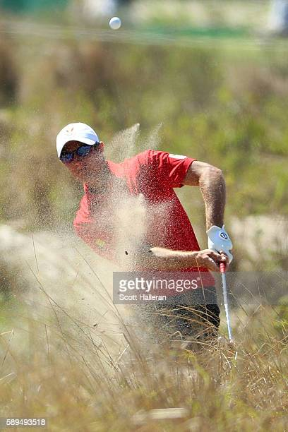 Nicolas Colsaerts of Belgium plays from a waste area during the final round of men's golf on Day 9 of the Rio 2016 Olympic Games at the Olympic Golf...