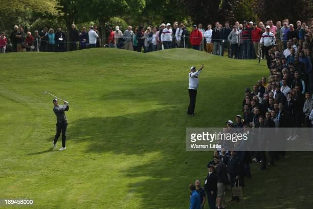 Nicolas Colsaerts of Belgium plays his approach on the first hole during the third round of the BMW PGA Championship on the West Course at Wentworth...